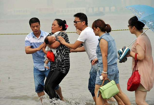 Desperate Mum Carries Disabled Baby Into River In Suicide Bid