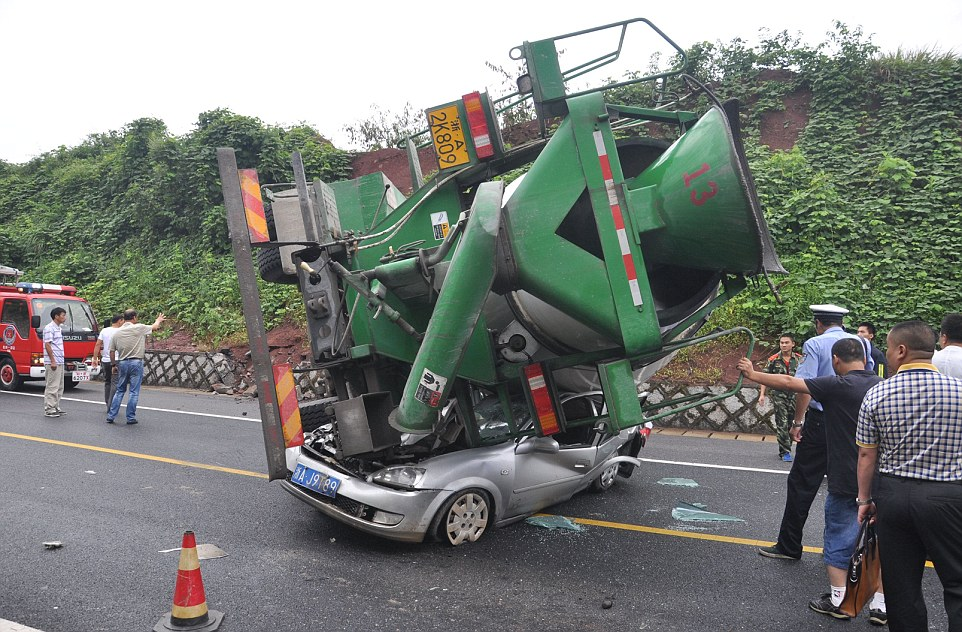 Woman Survives After Her Car is Flattened by a Cement Mixer, Hangzhou, Zhejiang Province, China - 18 Aug 2014