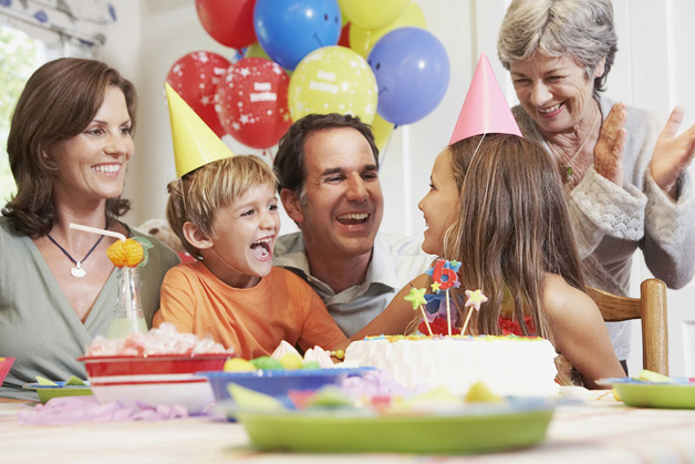 Family celebrating daughter's birthday --- Image by © HBSS/Corbis