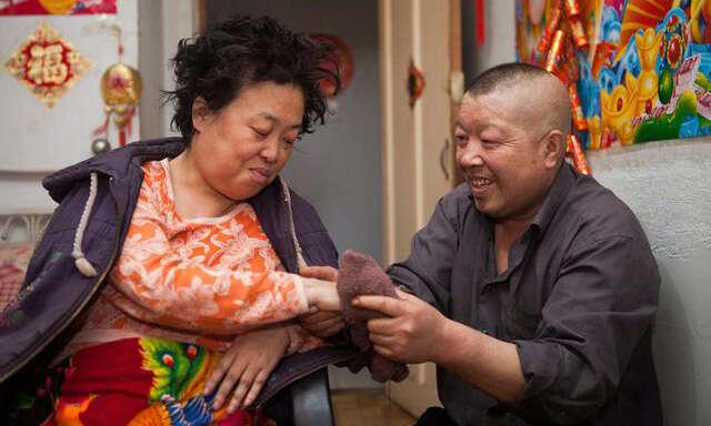 Xu Wenwu e sua esposa Wang Xiaoying