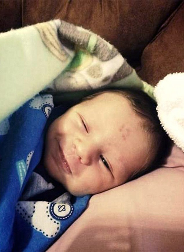 "Baby born with the number ""12"" on forehead"