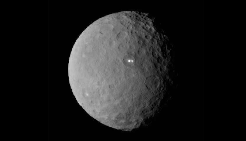 Ponto luminoso em planeta próximo a Plutão intriga especialistas
