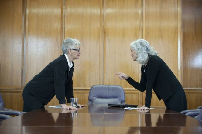 Caucasian businesswoman arguing in conference room