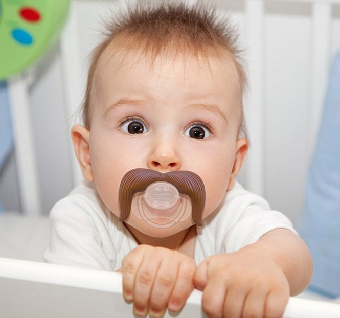 Things looking hairy for baby with moustache pacifier