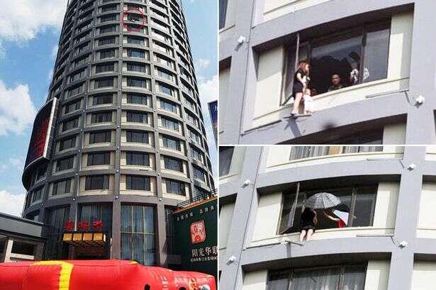 Mulher prestes a saltar de prédio