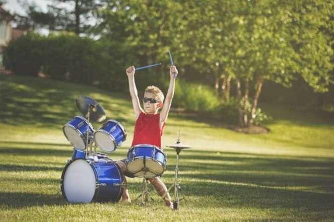 Boy playing drum set outdoors