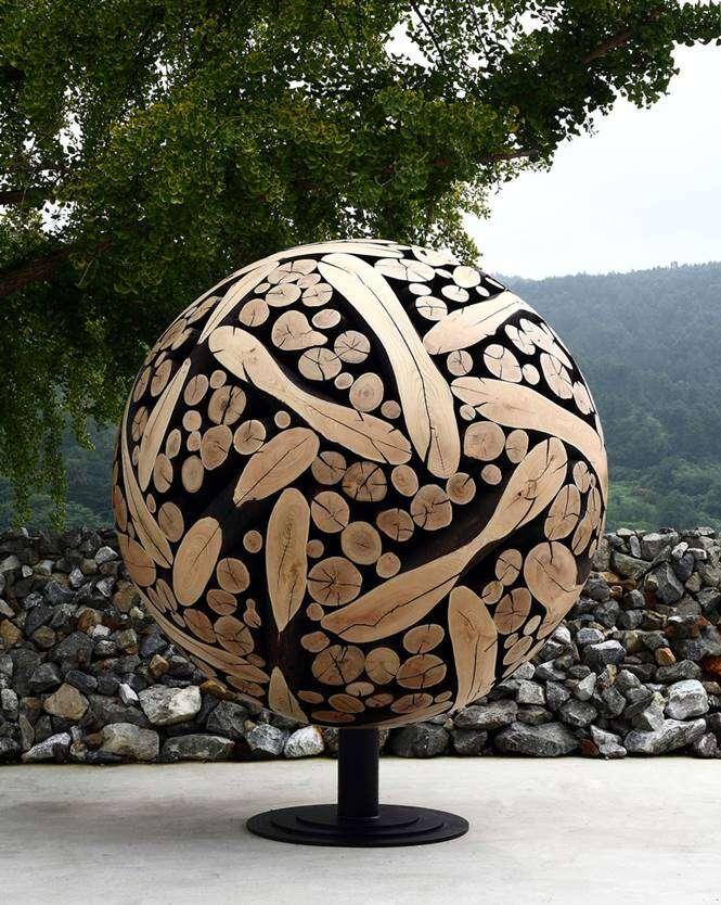 Arte em troncos de árvore
