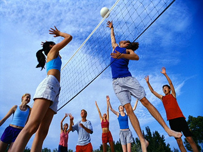 ca. 2002 --- Teenagers Playing Volleyball --- Image by © Roy Morsch/CORBIS