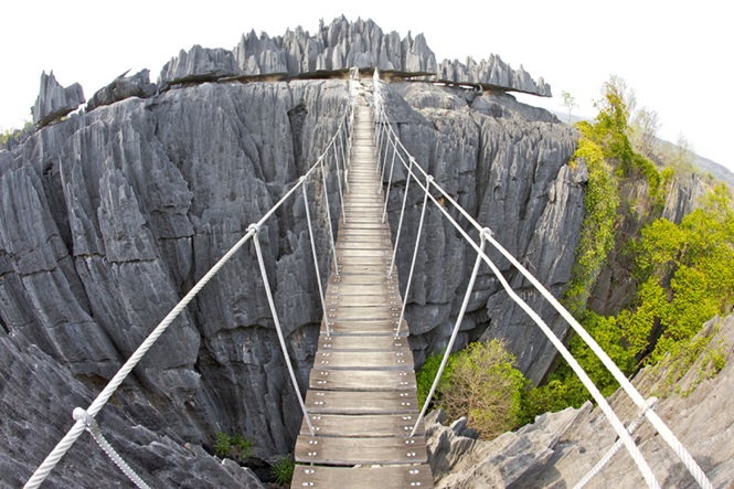 View of the suspension bridge across the Grand Tsingy landscape in the Tsingy de Bemaraha National Park in western Madagascar.