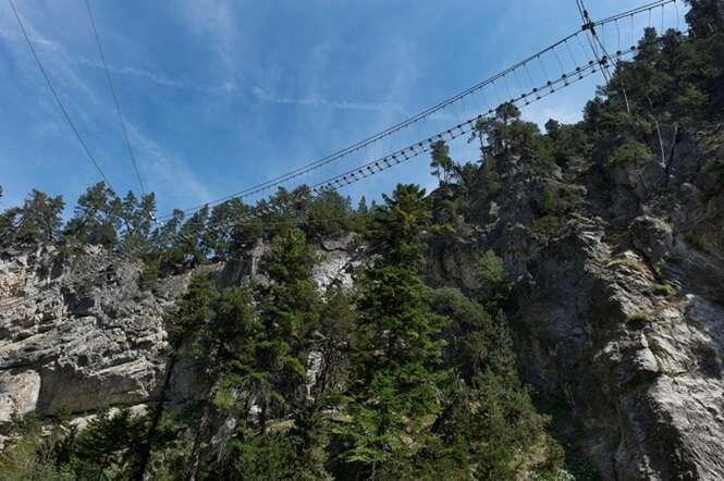 a Tibetan bridge over the St. Gervasio gorges, Susa valley, Piedmont, Italy