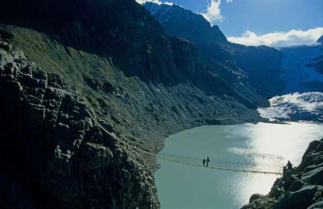 Lake Trift Switzerland Canton of Bern Bernese Oberland lake glacier mountains suspension bridge traveller Landscape scenery