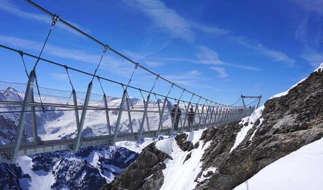 Suspended walkway over snow mountains Titlis, Engelberg, Switzerland