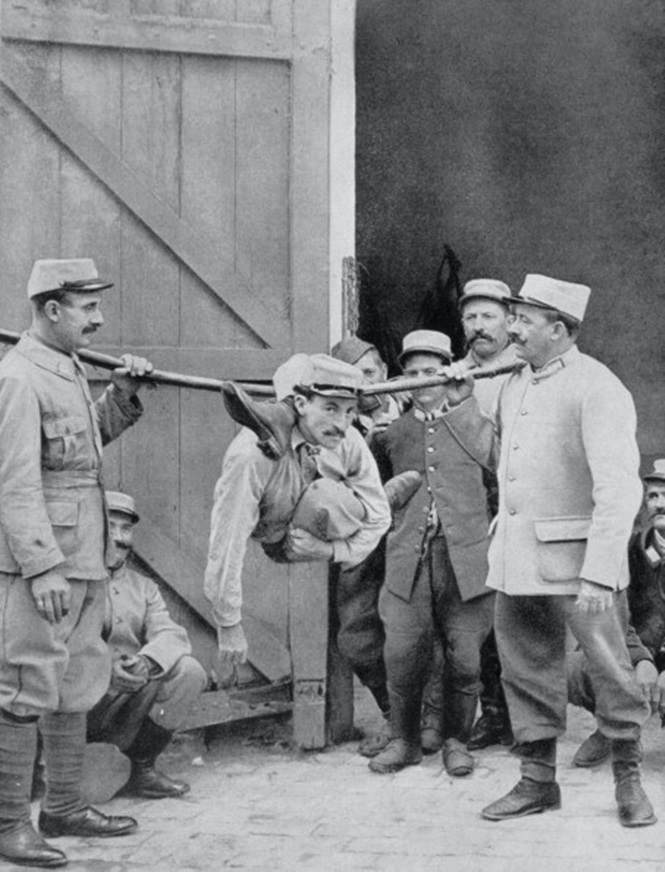 Distractions at the front; the 'human serpent', France, World War I,1915.
