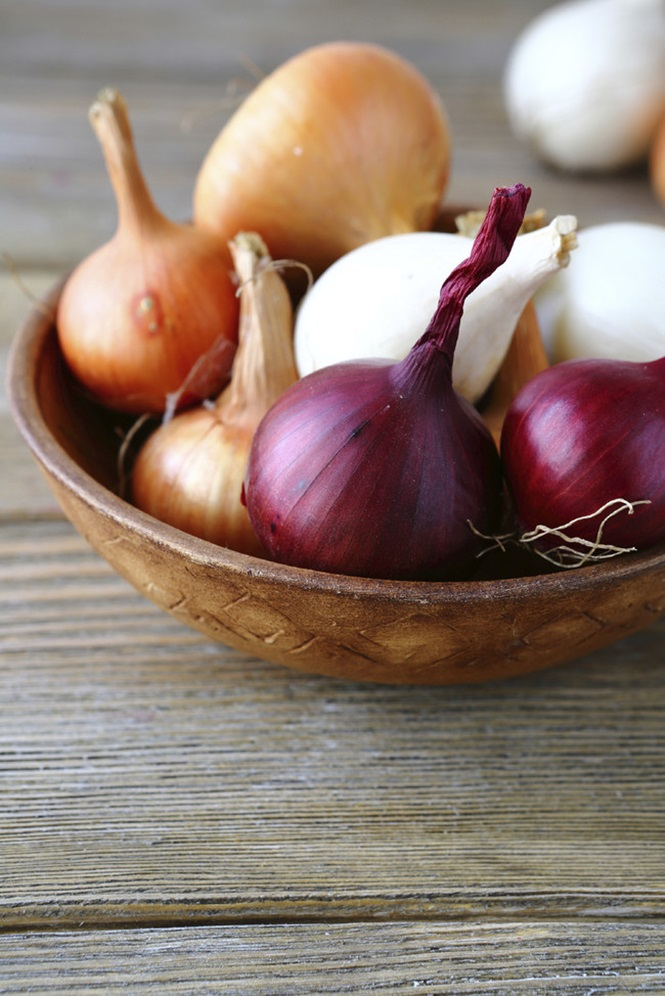 Onions in a wooden bowl