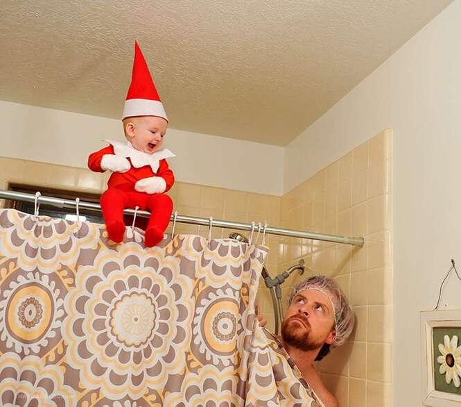 Pai captura fotos incríveis transformando seu bebê em duende do Papai Noel