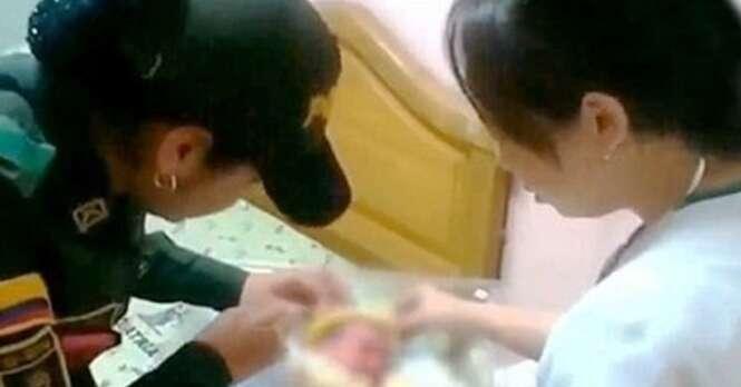 Policial salva vida de bebê abandonado o amamentando após resgate