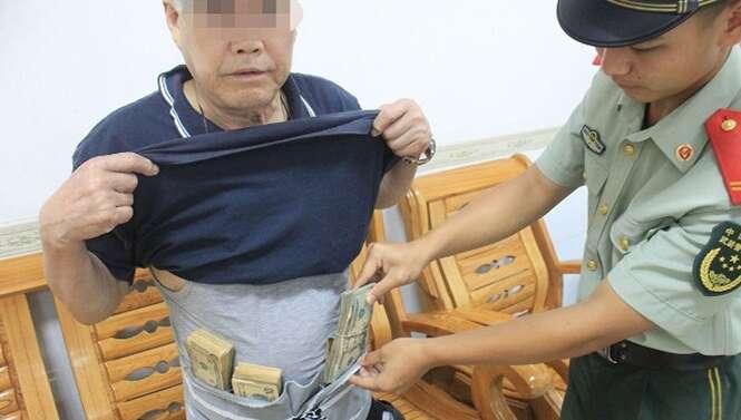 Homem é flagrado tentando cruzar fronteira para Hong Kong com R$ 250 mil amarrados à cintura