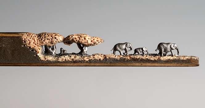 Artista esculpe família de elefantas na ponta de um lápis