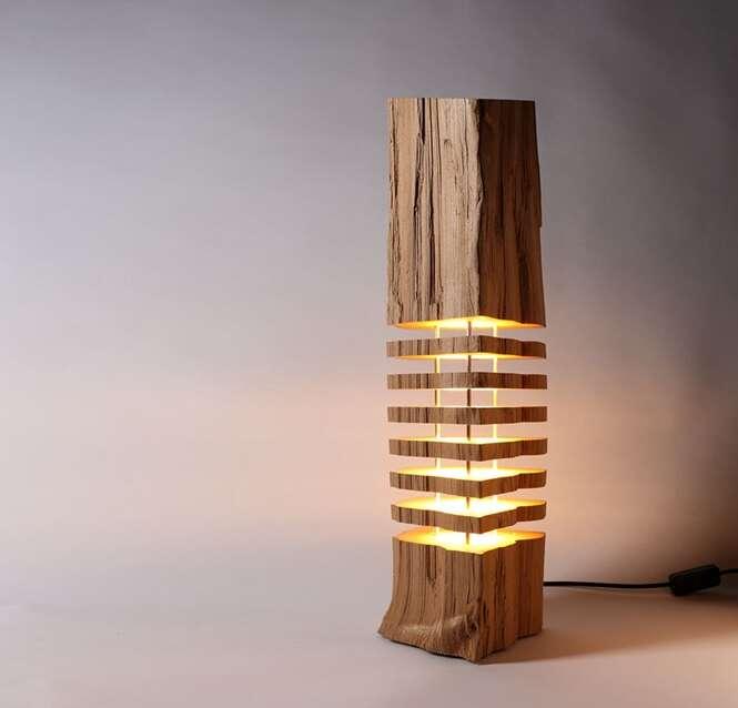 Artista cria luminárias em troncos de árvore